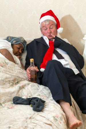Wife pretending to sleep while drunk husband gets to bed photo