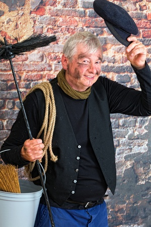 Charming chimney sweep greeting with his cap Stock Photo - 16054499
