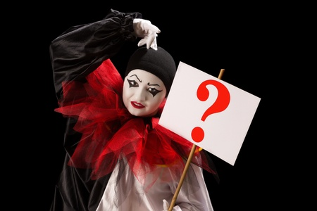 pierrot: Young Pierrot holding a sign with a question mark Stock Photo