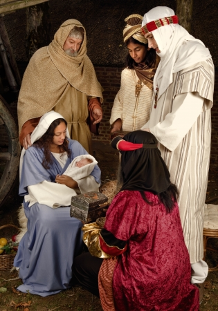 Live Christmas nativity scene reenacted in a medieval barn photo