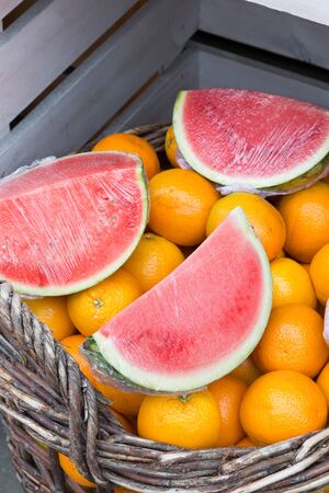 greengrocery: Cut pieces of watermelon and fresh oranges at a greengrocery shop Stock Photo