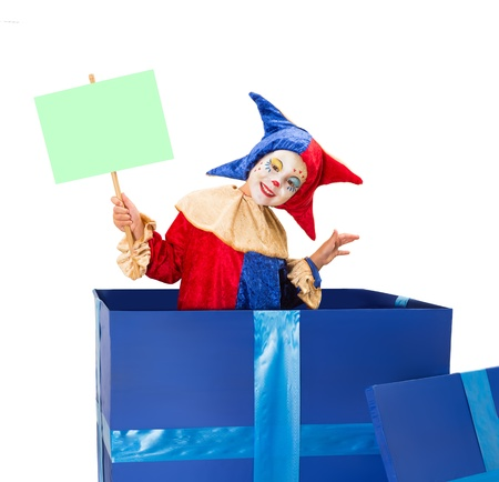 harlequin clown in disguise: Lovely little clown girl in a blue surprise box with blank sign card