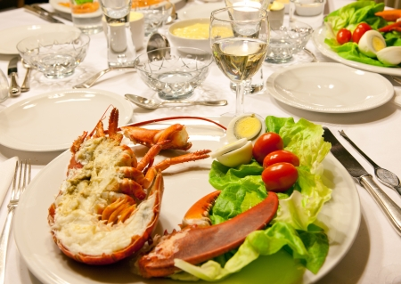 lobster dinner: Luxury dinner table with fresh lobster and salad Stock Photo