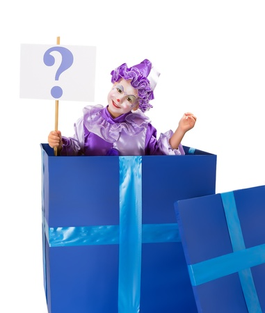 Young girl clown popping out of a surprise box with a big question mark photo