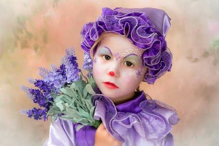 Beautiful portrait of an adorable clown girl with lavender flowers photo