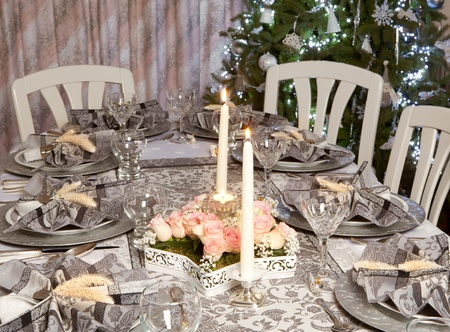Fancy christmas dinner table with decorated napkins photo