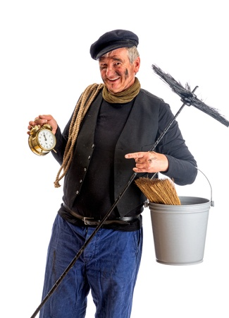 Smiling chimney sweep showing midnight New Year on his alarm clock photo