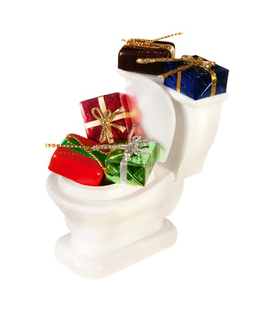 disposed: White miniature toilet pot filled with gifts and presents