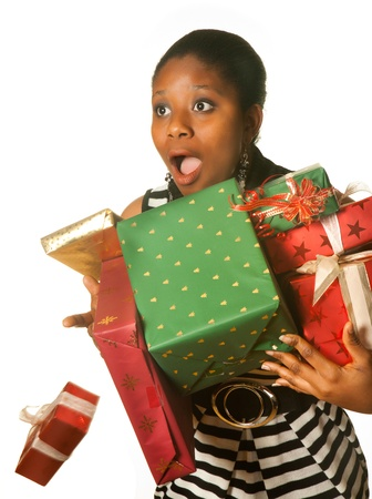 Surprised african girl dropping her christmas presents photo