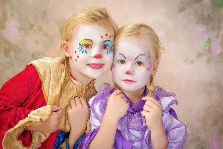 face paint: Portrait with painting effect of two adorable clown girls