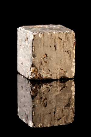 sulfide: Unpolished block of pyrite mineral, an iron sulfide resembling gold. Often confused with gold and therefore also called Fools Gold