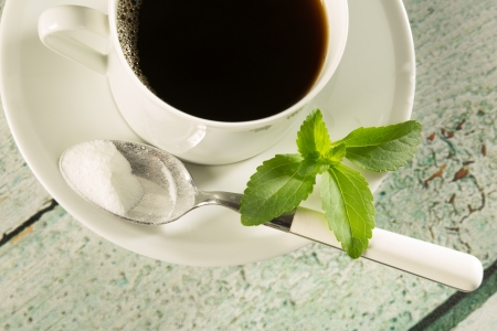Highkey image of a cup of coffee with natural sweetener stevia photo
