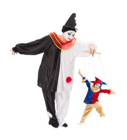 puppet show: Living marionette clown on strings and a live pierrot doll