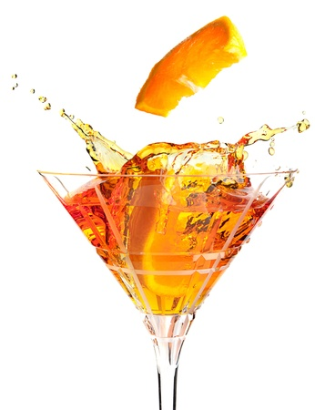 causing: Slices of orange causing splashes in a cocktail