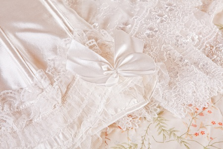 Closeup of white sexy lace lingerie waiting for the bride photo