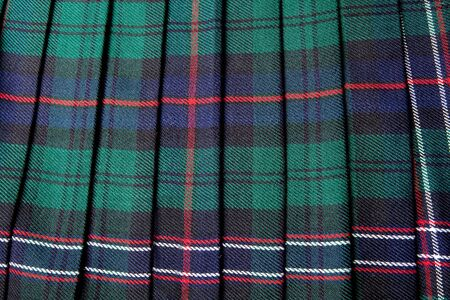 checkered skirt: Scottish tartan pattern, part of a traditional kilt Stock Photo