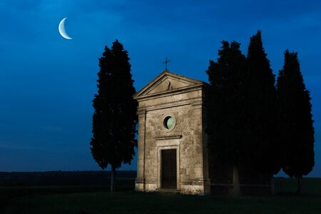 Tuscan chapel at night painted with light, shot in the hills of Tuscany near Pienza photo