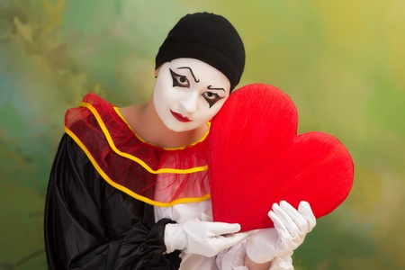 Sad Valentine Pierrot holding a red heart photo