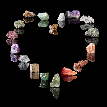mineralogy: Heart shape collection of semi-precious gemstones and birthstones. Smokey Quartz, Rock Crystal, Amethyst, Agate, Olivine, Rock Salt, Vanadinite, Chalcedone, Wavellite, Malachite, Pyrite, Clear Quartz, Fluorite, Jasper, Peridote, Citrine, Green Fluorite