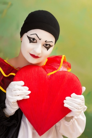 Valentine Pierrot in love holding a red heart photo