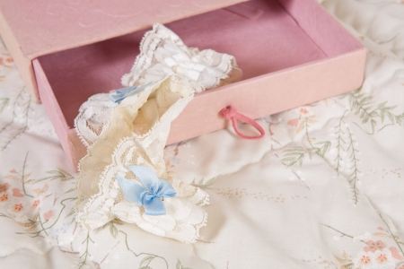 Bridal garter with blue bow in a pink gift box Stock Photo - 17218712