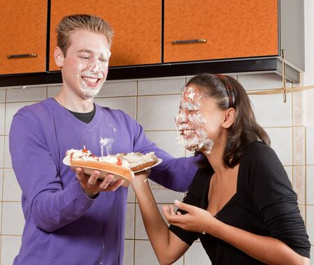 Funny pie fight between a young couple Stock Photo - 17341901