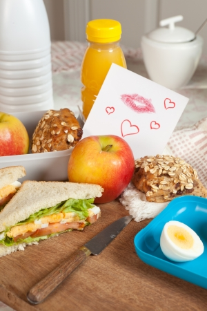Lunchbox with a love note on the breakfast table Stock Photo - 17346555
