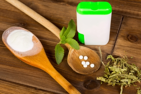 Zero-carb sweetener stevia as powder, tabs and dried leaves Stock Photo - 17475098