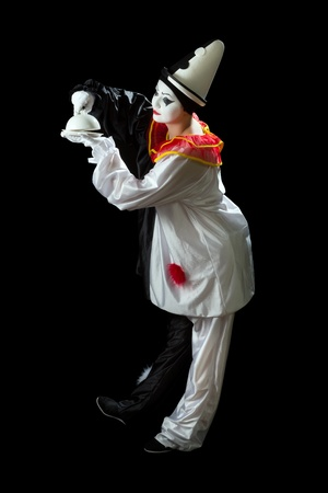 pierrot: Curious clown uncovering the lid of a surprise  Stock Photo
