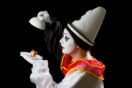 Mime Pierrot actor finding a gift under on a white dish tray Stock Photo - 17448016