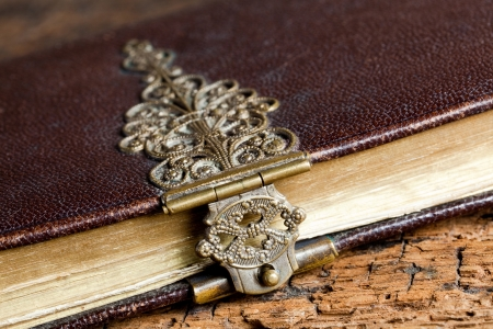 Grungy brass lock on a beautiful old book Stock Photo - 17475099