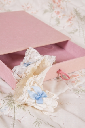 Pink present with cream and blue garter for the bride photo