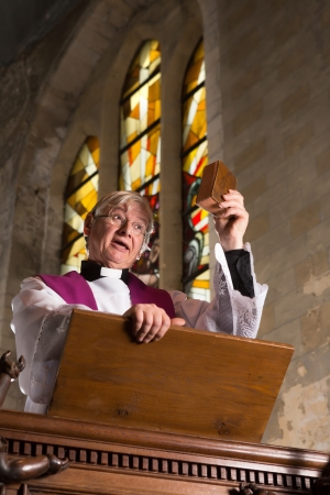 preaching: Priest preaching during mass on Sunday in an old church