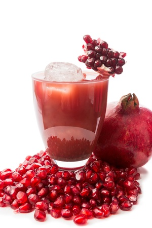 Colorful cocktail with pomegranate juice decorated with a cut fruit Stock Photo - 17779413