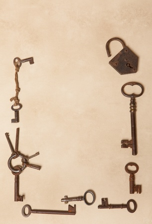 Rusty keys forming a border with copy space Stock Photo - 17779421