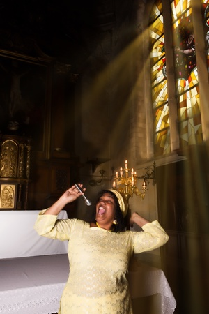 17th: African-American gospel singer in a 17th century old church interior