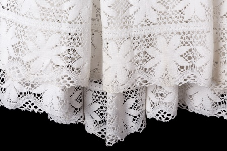 vestment: Detail of the white lace edge of a catholic priest surplice