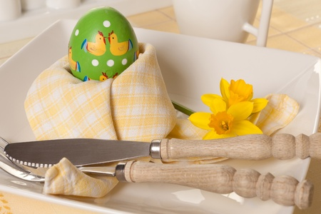 Decorated Easter table with napkin folded around an easter egg Stock Photo - 17779436