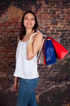 Smiling happy woman with shopping bags in her hand photo