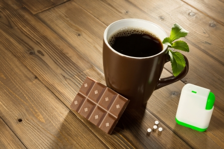 Cup of coffee with stevia sweetener tablets and Belgian chocolate without sugar photo