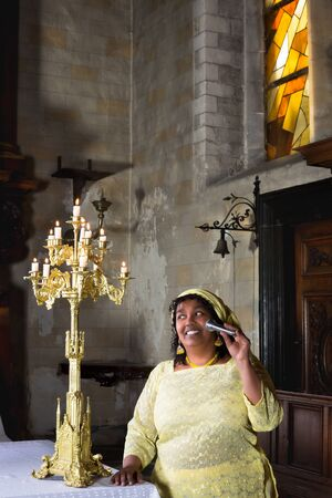 Religious hymns sung by a mature gospel singer in church photo