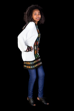 Young smiling Ethiopian girl doing the traditional shoulder dance Stock Photo - 18523000