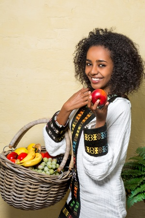 Young pretty Ethiopian woman wearing traditional costume photo