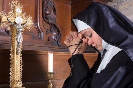 black nun: Closeup of a young nun in prayer  Stock Photo