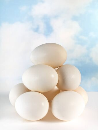 eachother: Mountain of eggs stacked on eachother in balance Stock Photo