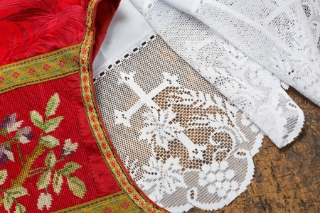Antique set of a white lace priest surplice and 19th century damask chasuble Stock Photo - 18684831