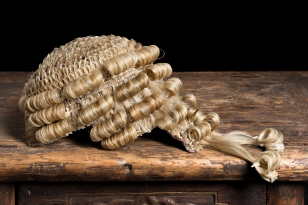 wig: Genuine horsehair barristers wig on an antique desk