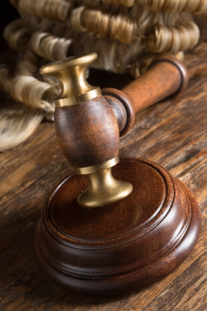 Judges wig and his gavel on wooden block