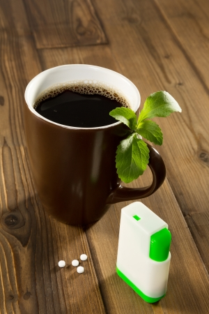 Mug of coffee with stevia tablets as natural and healthy sweetener photo