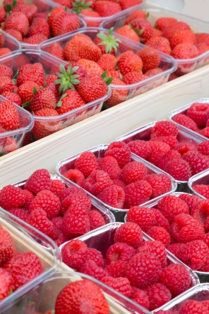 greengrocery: Fresh raspberries and strawberries on display at a greengrocery shop